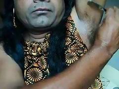 Indian girl shaving armpits hair by strai ...